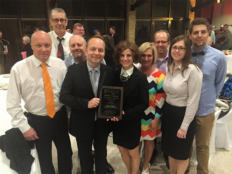 photo of Dr. Schneider team receiving Outstanding Business of the Year