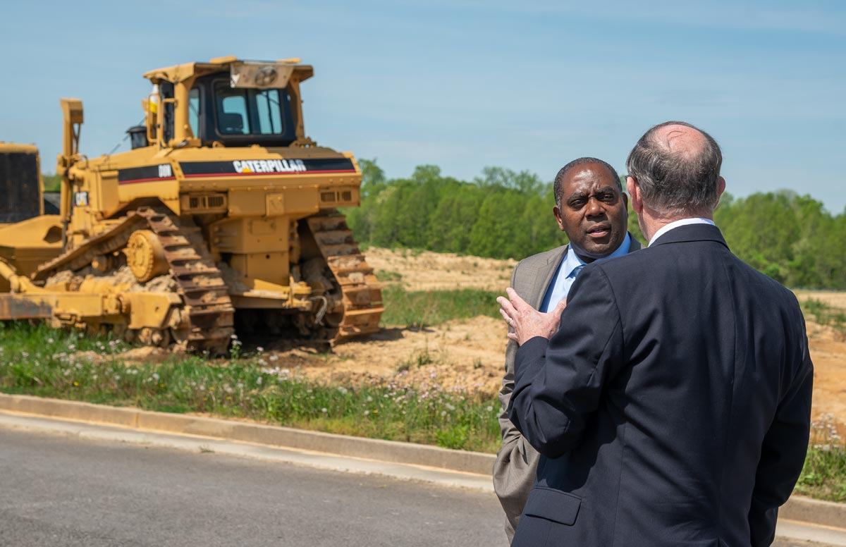 Erran Persley with the Kentucky Cabinet of Economic Development discusses the build-ready pad with RCIDA Executive Director Bennie Garland at the Lake Cumberland Regional Industrial Complex Build-Ready Pad  construction site.